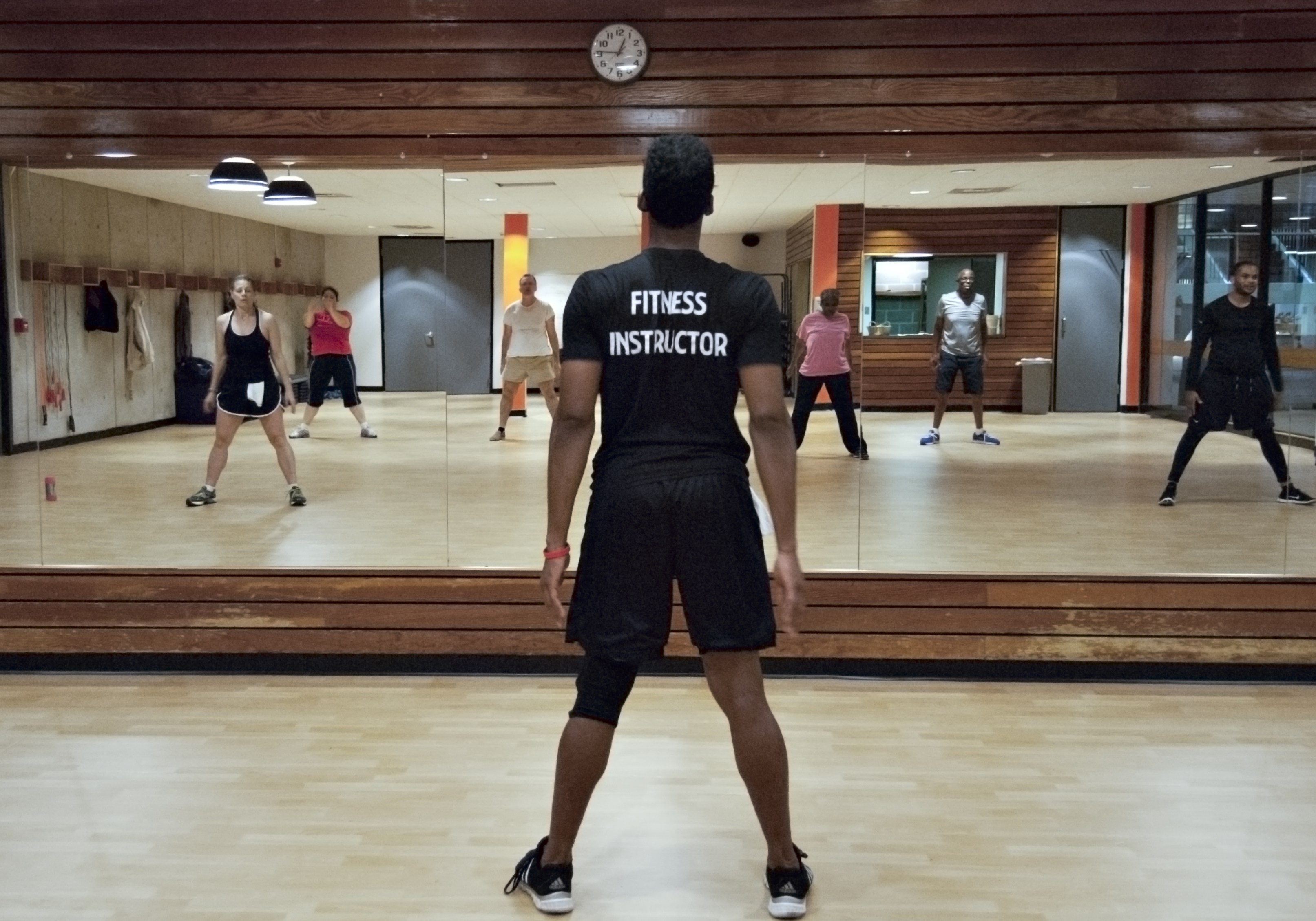 fitness instructor leading fitness class