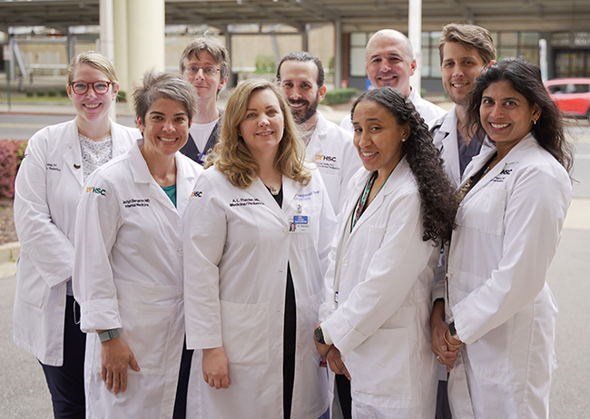 Four UTHSC GIM hospitalists in white coats