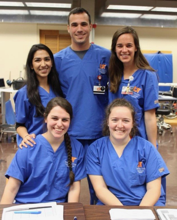 Group of students in scrubs.