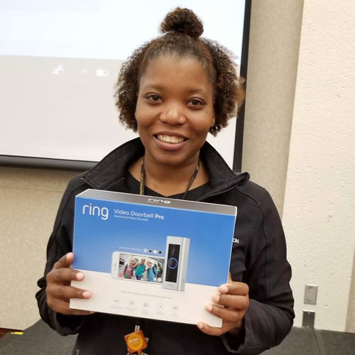 Lady with a prize she won at the Tech Fair