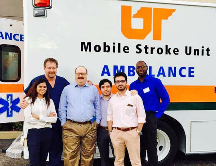 Residents/faculty outside by the Mobile Stroke Unit
