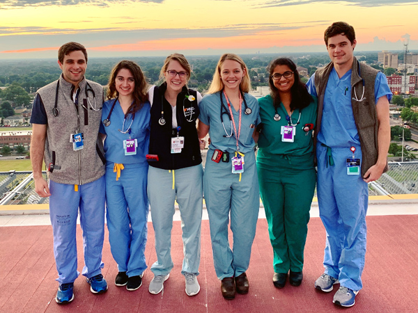 Night shift residents on the hospital roof