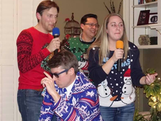 Residents singing karaoke at a Christmas party
